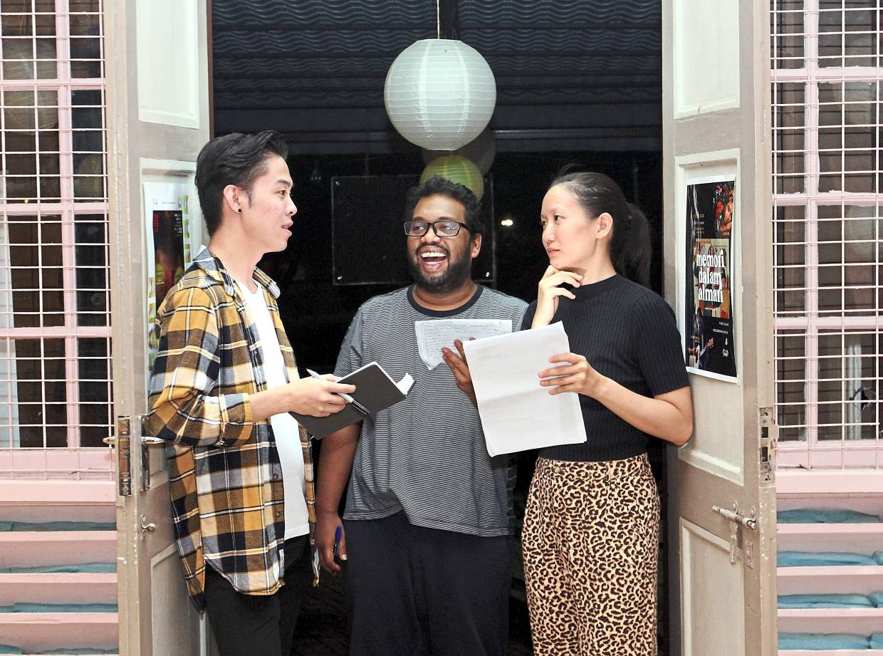 Director Choy (left) discussing the show at a rehearsal with Ashraf and Ng, who plays Dewi. Photo: The Star/Azlina Abdullah