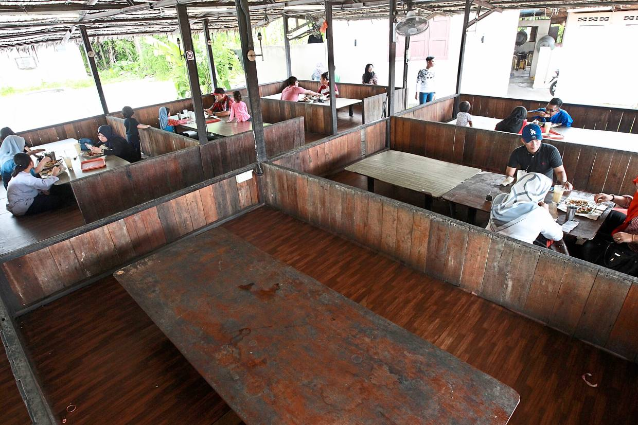 Customers can also sit on the floor to eat their meals at Warung Kita. — Photos: NORAFIFI EHSAN/The Star