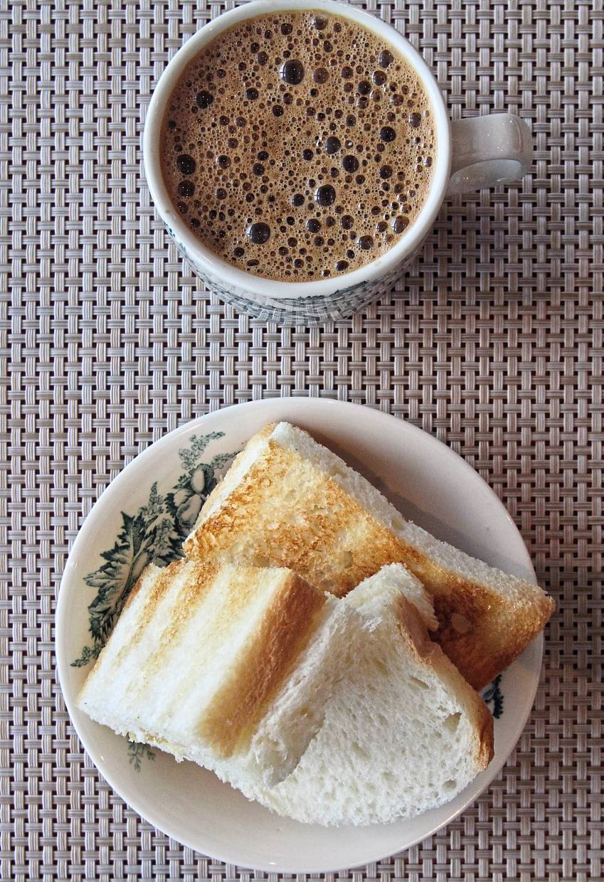 Enjoy toasted bread with freshly 'pulled' coffee at the Kopitiam Counter.