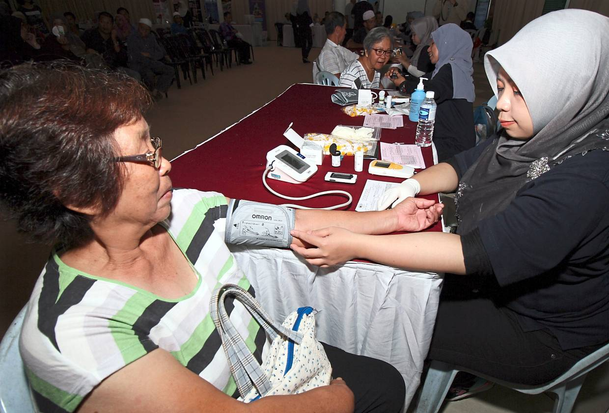 A woman gets her blood preasure checked at a health screening event in this filepic. Research has found that magnesium can help lower blood pressure in those with hypertension.