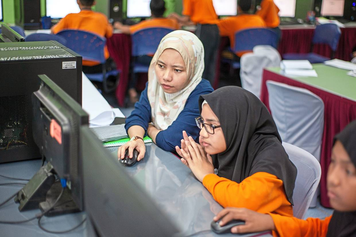 Nabihah (left) says at the end of the GEMS programme, the girls will be asked to present their robotics project at a community exhibition such as the Penang International Science Fair. — Arus Academy