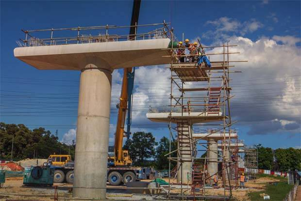 Construstion worker workers are busy building the 37-kilometer LRT3 (initial name) or LRT Bandar Utama–Klang line.-Art Chen/The Star.