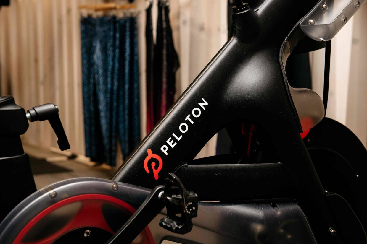 Peloton has had a hit selling stationary exercise bicycles along with memberships to streaming online workout sessions that people can take part in from home. — AFP