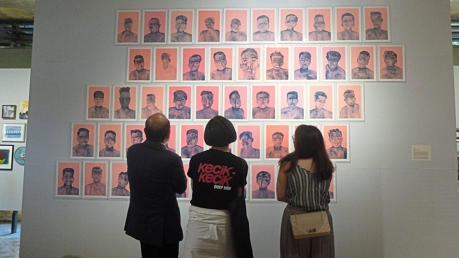 Visitors taking a look at 'Metamorfosis' by artist Tang Tze Lye at 'The Kecik Kecik Group Show Finale' at the Hin Bus Depot in October 2019. Photo: Andrea Filmer