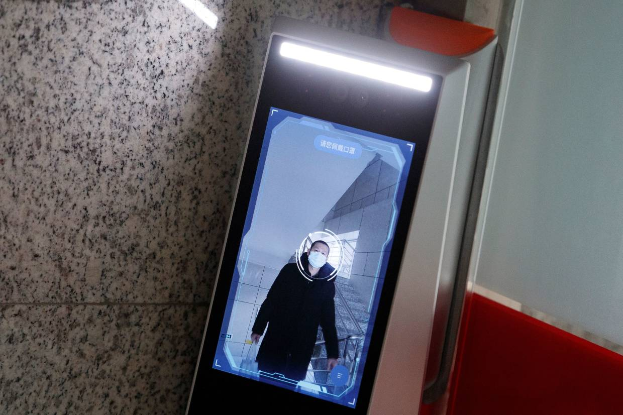 A man has his face scanned by a facial recognition device that identifies people when they wear masks to gain access to the office of the Chinese electronics manufacturer Hanwang (Hanvon) Technology in Beijing as the country is hit by an outbreak of the novel coronavirus (Covid-19), China.