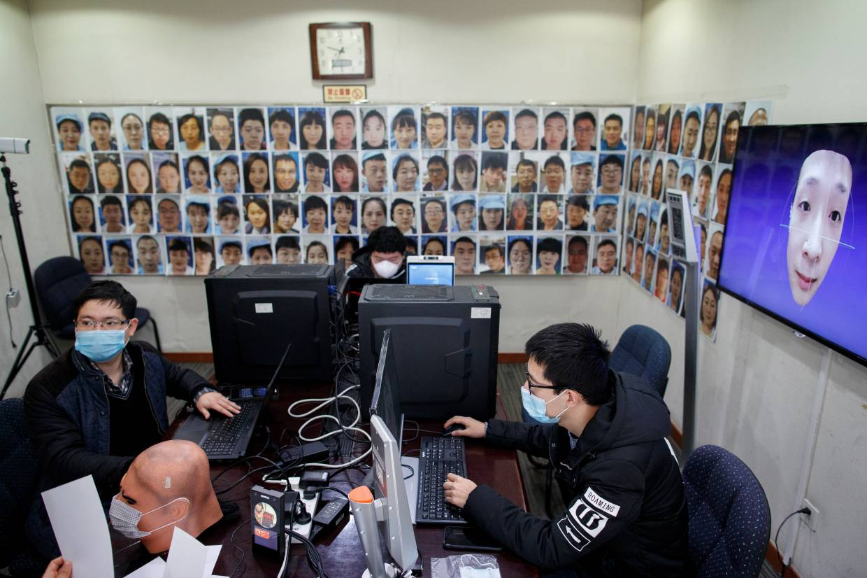 Software engineers working on a facial recognition program that identifies people when they wear a face mask at the development lab of the Chinese electronics manufacturer Hanwang (Hanvon) Technology in Beijing.