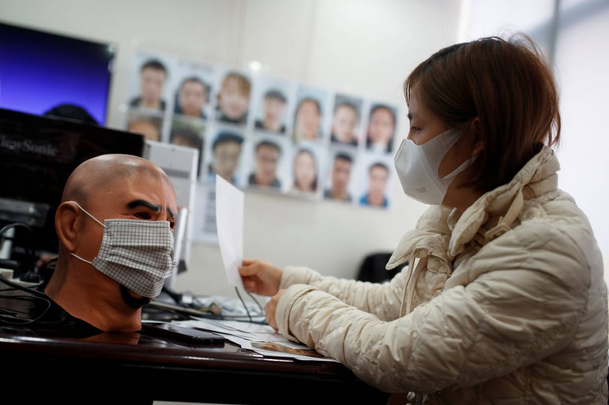 A software engineer testing a facial recognition program that identifies people when they wear a face mask at the development lab of the Chinese electronics manufacturer Hanwang (Hanvon) Technology in Beijing.