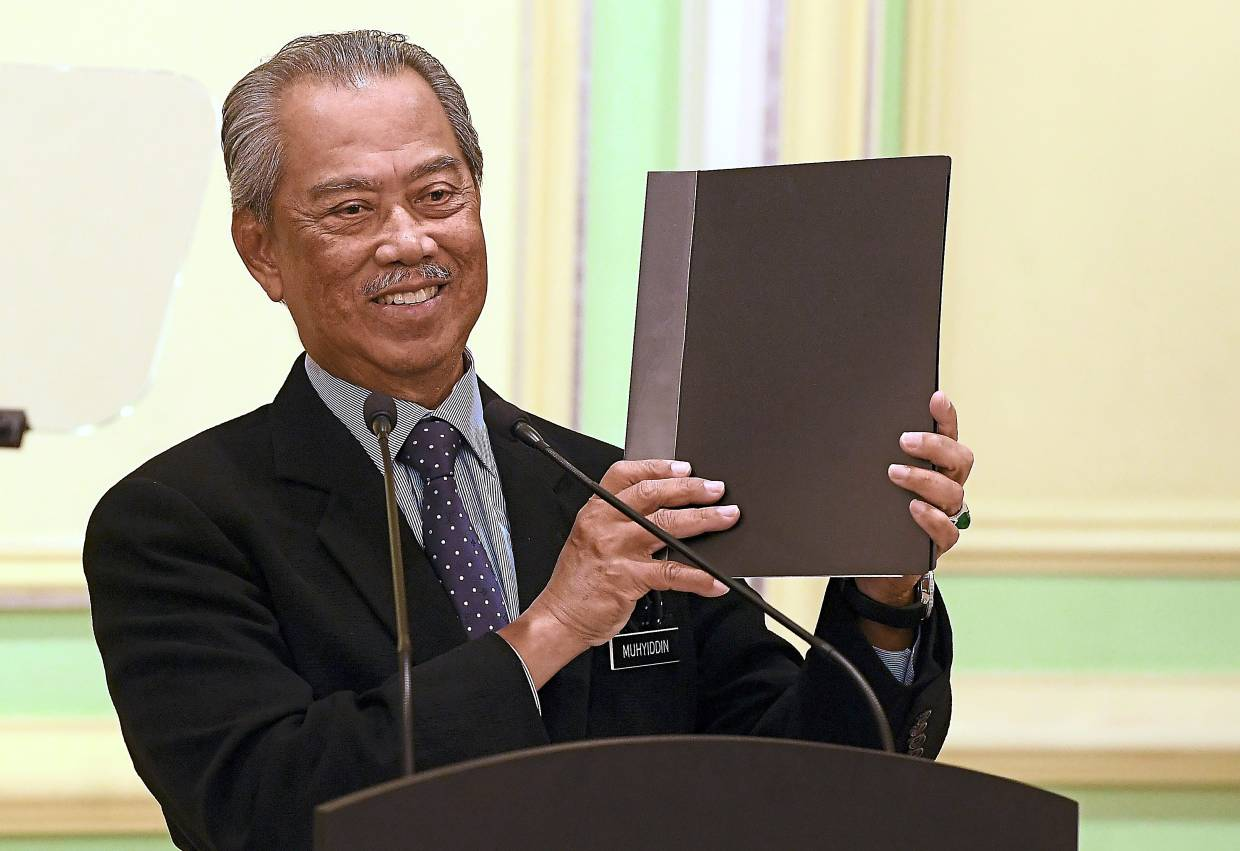 In with the new: Muhyiddin beaming with pride just before announcing the line-up of ministers and deputy ministers at the Perdana Putra building in Putrajaya. — Bernama
