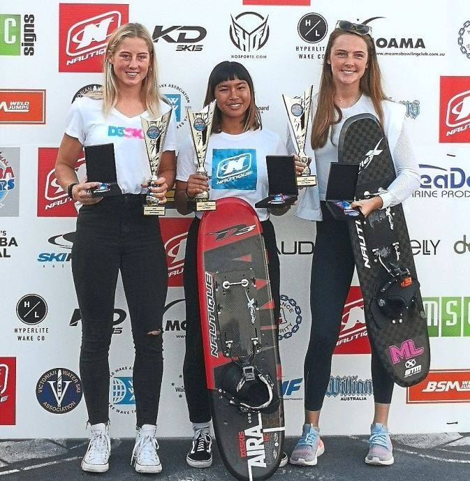 Aaliyah flanked by Sade (left) and Tayla after receiving their prizes in Melbourne last weekend.