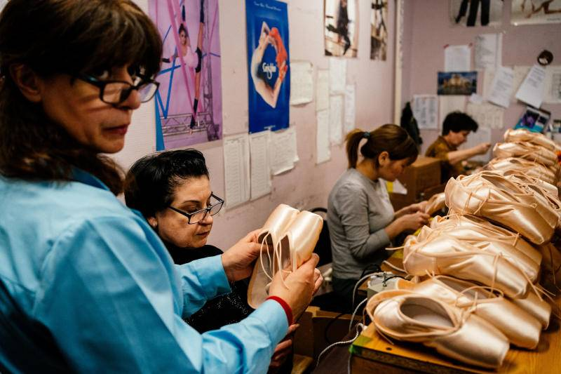 Employees of Grishko company produce pointe shoes in the company's Moscow workshop. Photo: AFP