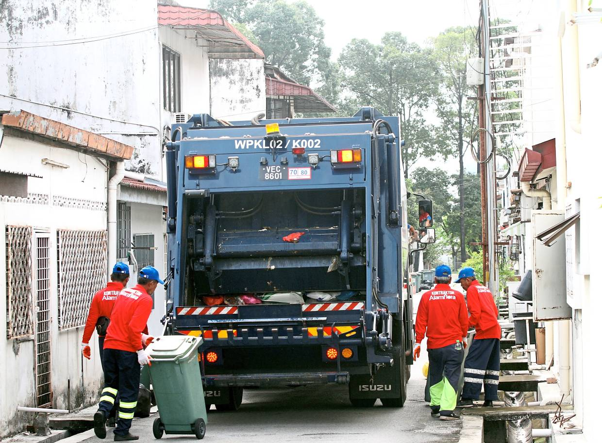 1 Rubbish collectors in the city begin work as early as 6.30am daily.