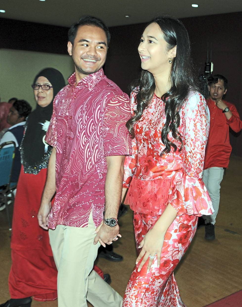 Meera and husband Mohamad Ezran arriving at the feast which is also held to celebrate their marriage.