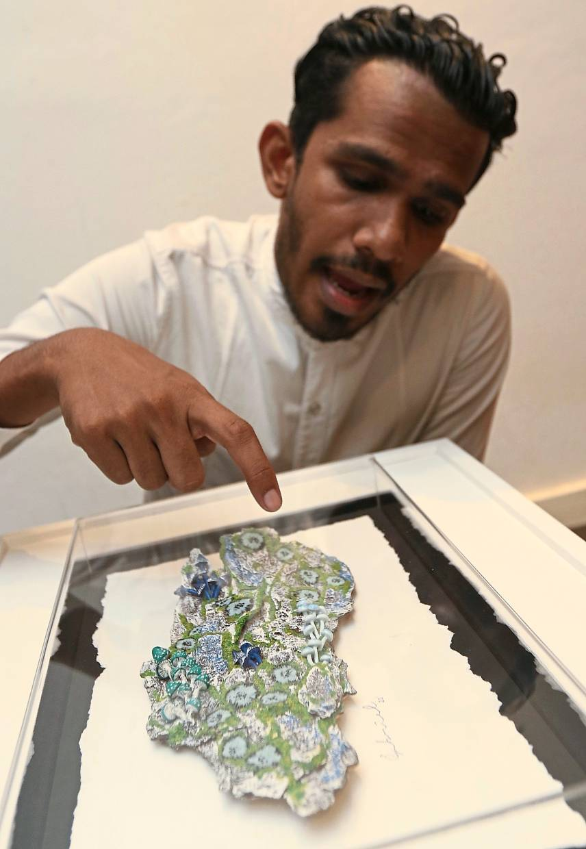 Ivan showing a piece titled 'Growth Series - Tree Bark VI'.