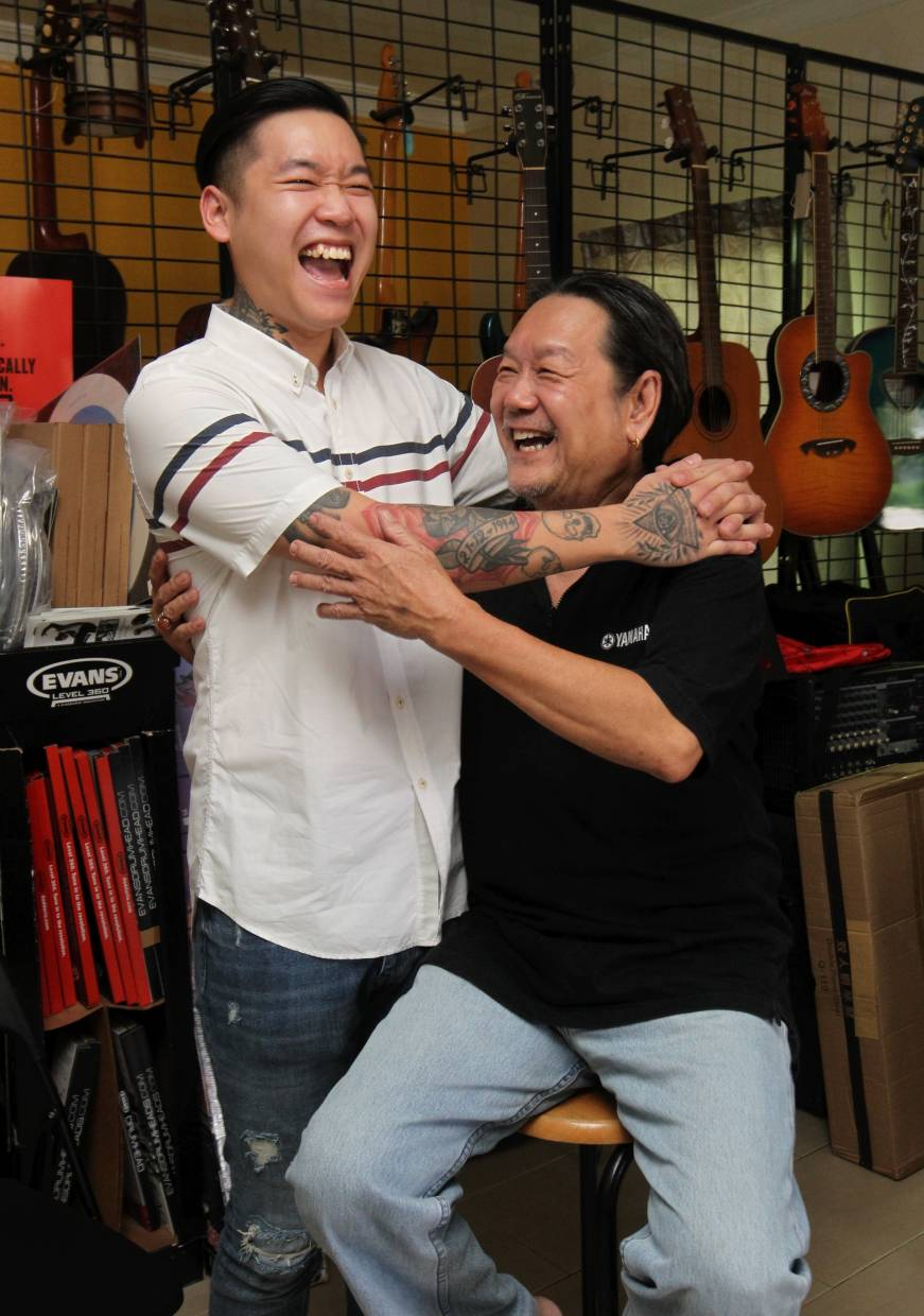 Father and son, Jimie and Ivan Loh, enjoy playing music together.