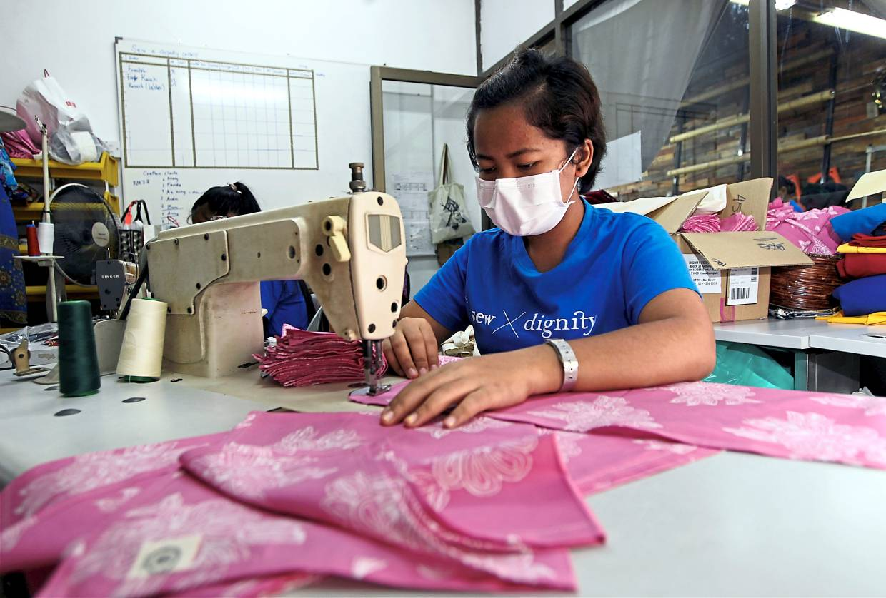 Maia learnt sewing skills at sew X Dignity and she sews items for The Olive Tree to earn a living. Photo: The STar/Kamarul Ariffin