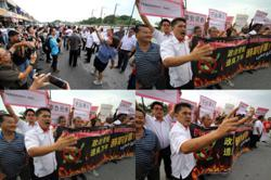 Angry crowd gather outside Tronoh rep Paul Yong's service centre