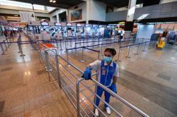 Thailand restricts visitor visas to limit virus spread