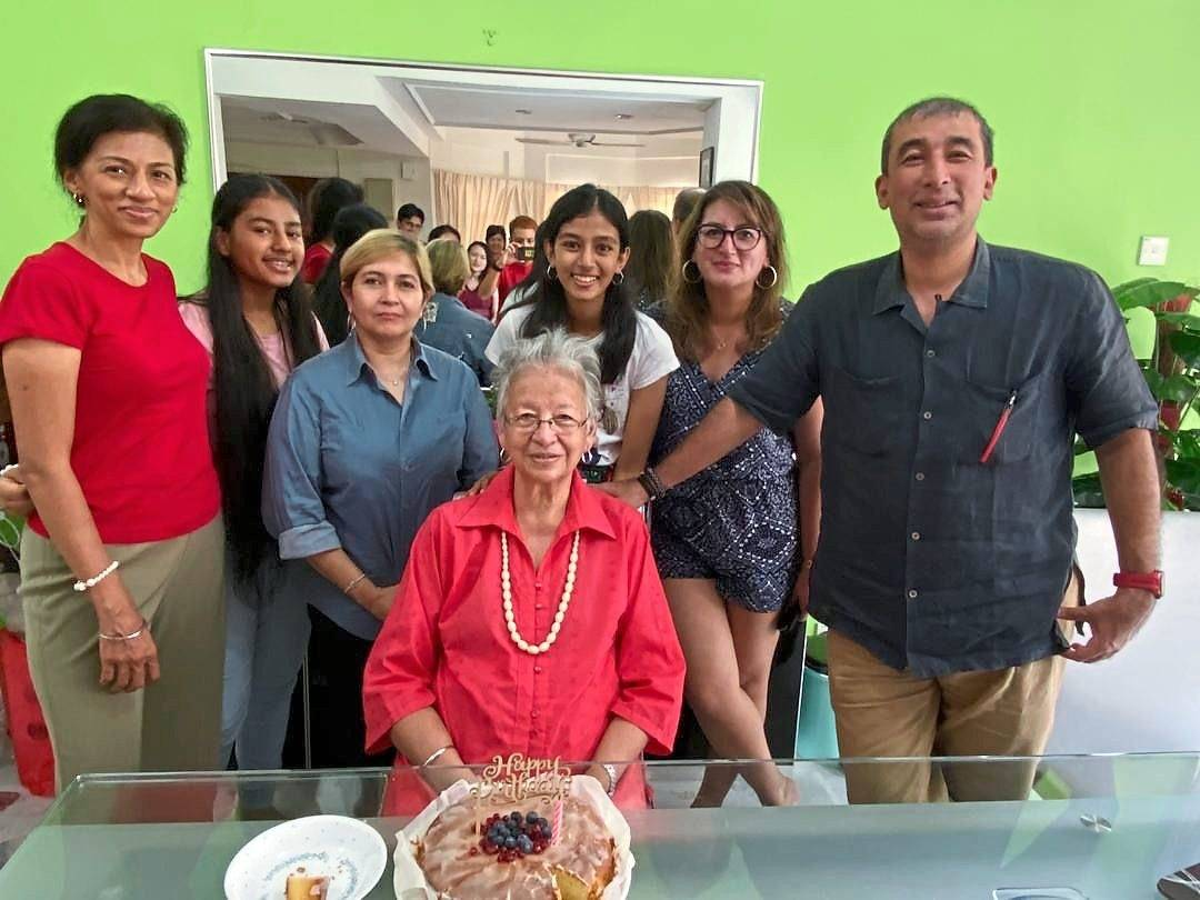 Ajaib (centre) with three of her four children and some of  her grandchildren during her 76th birthday celebration recently. Photo: Sarjit Kaur
