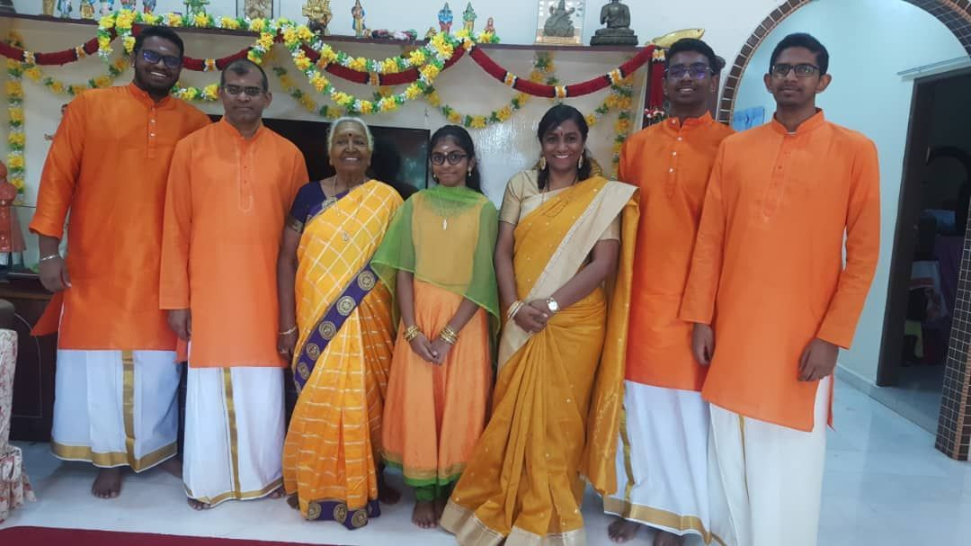 Magiswary and her husband Maniam (second from left) teach their sons to respect girls and women.
