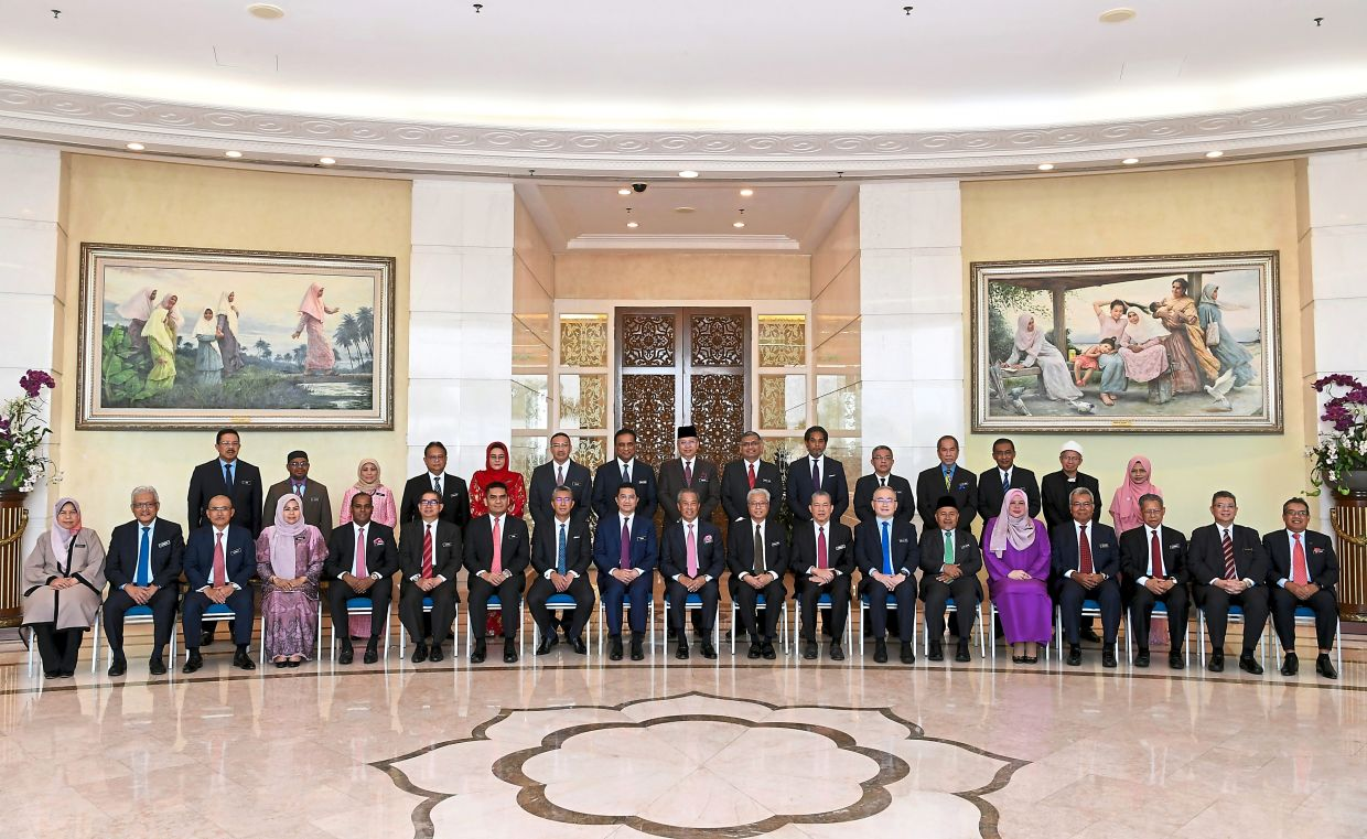 Ready to serve: Muhyiddin (seated centre) posing with his ministers before chairing the first new Cabinet meeting at the Perdana Putra on Wednesday.