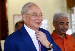 Woman denies marrying Najib, files report
