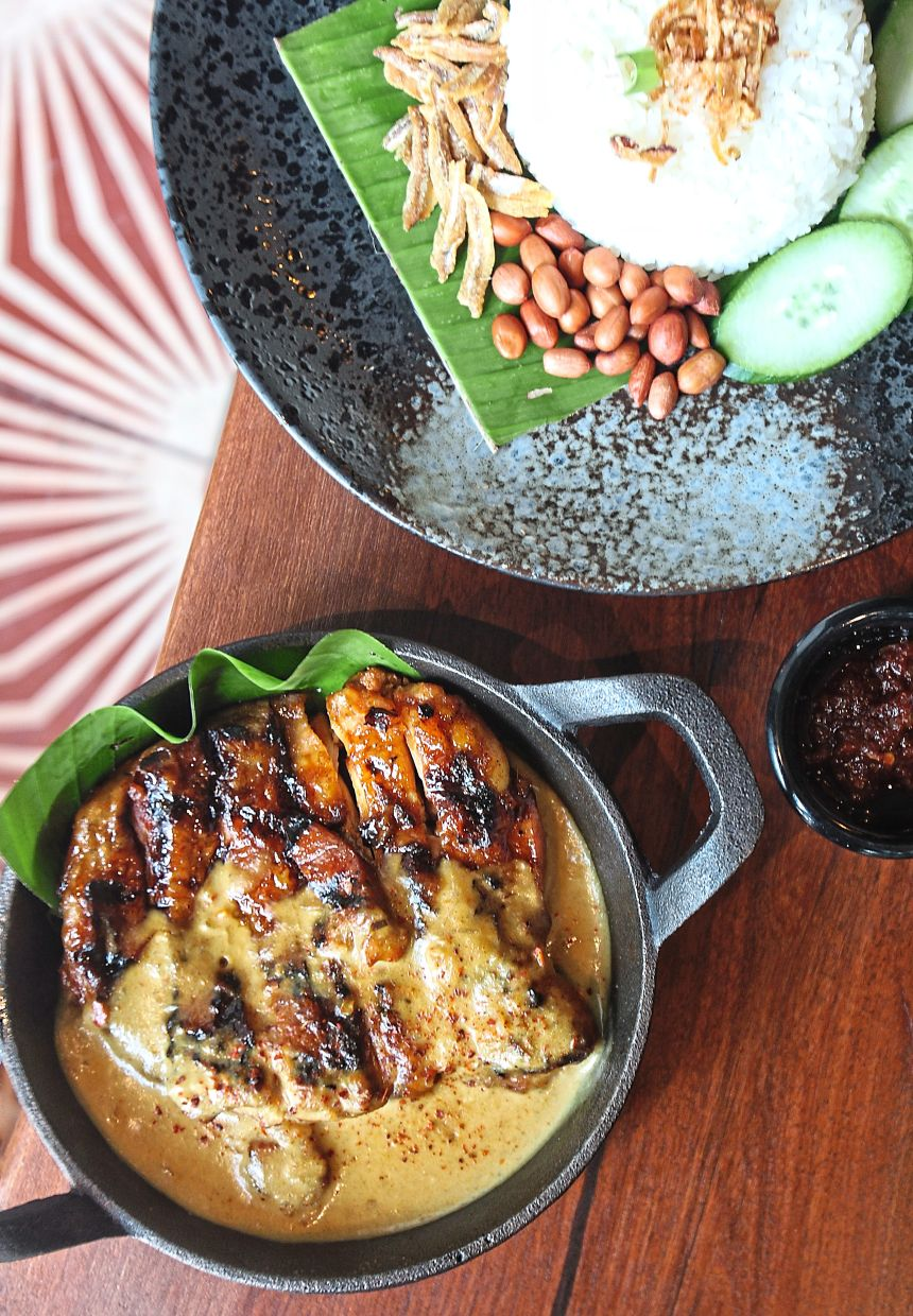 Nasi Lemak Ayam Bakar Nale with a side of baked chicken in Nale sauce.