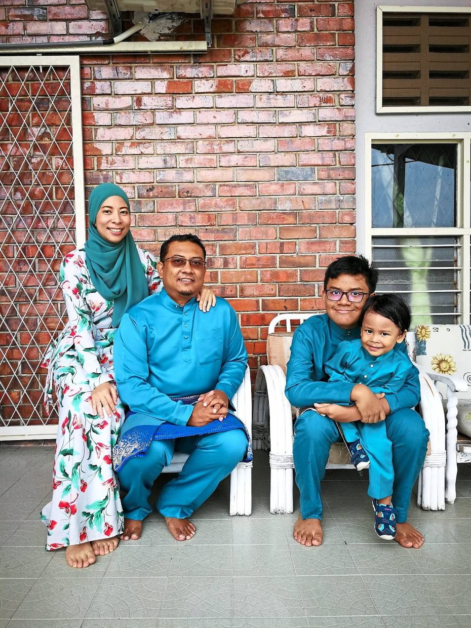 Yusniza (left) credits her husband for being the backbone of their family of four.