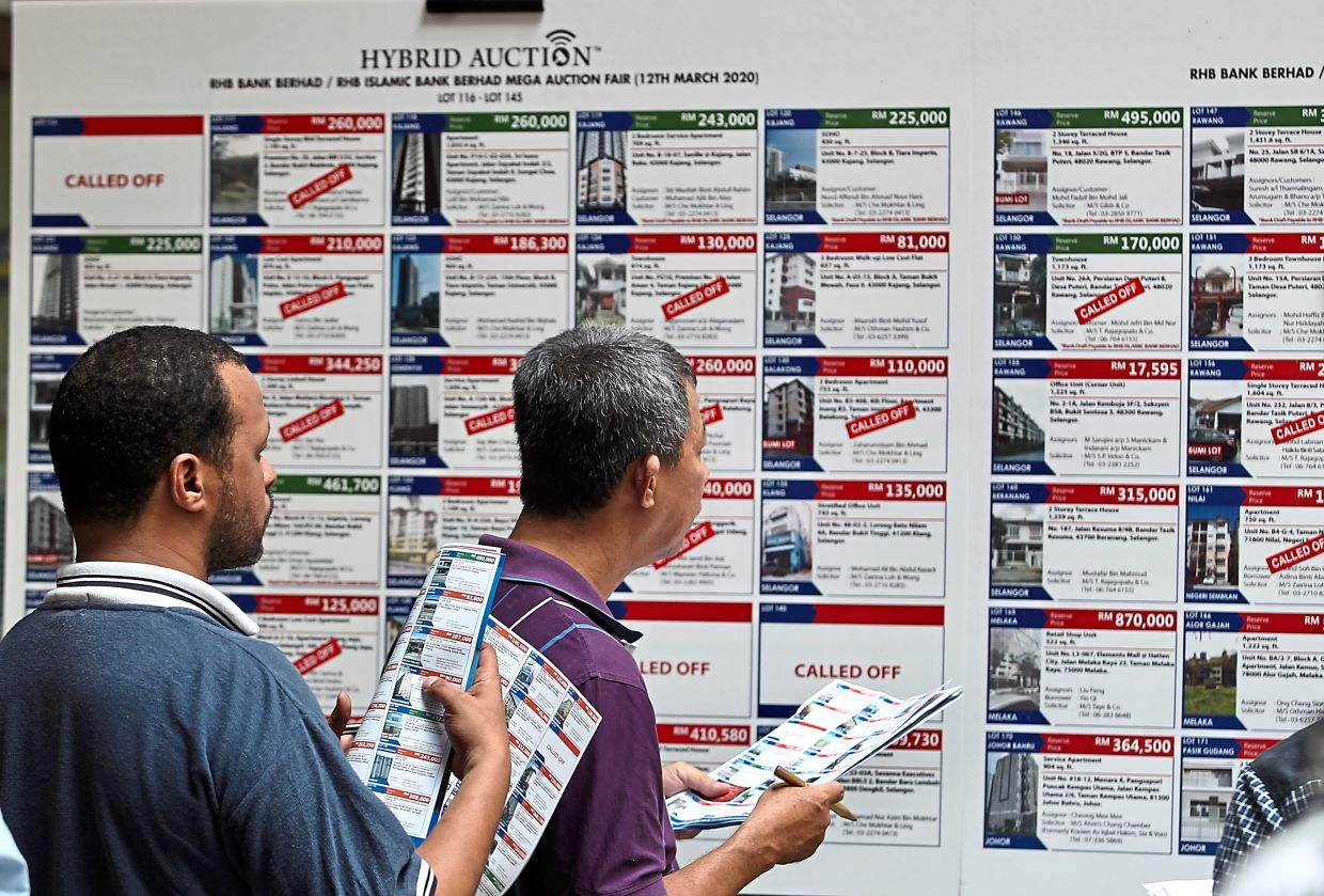 Bidders checking details on mixed properties for the hybrid auction at RHB Bank Mega Auction Fair in Kuala Lumpur.