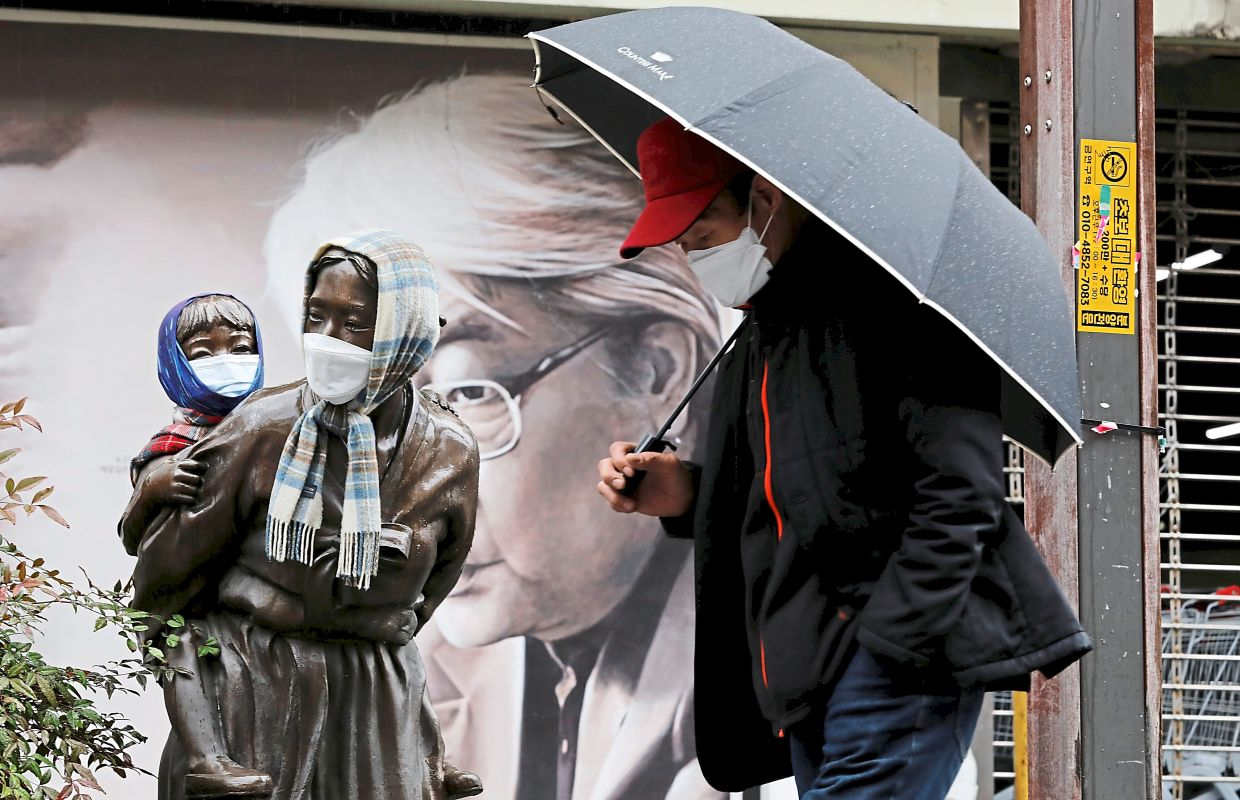 7. Public art can be a part of the conversation. Here a man wearing protective mask walks past a statue also with masks on, following an outbreak of Covid-19 in Daegu, South Korea. Photo: Reuters