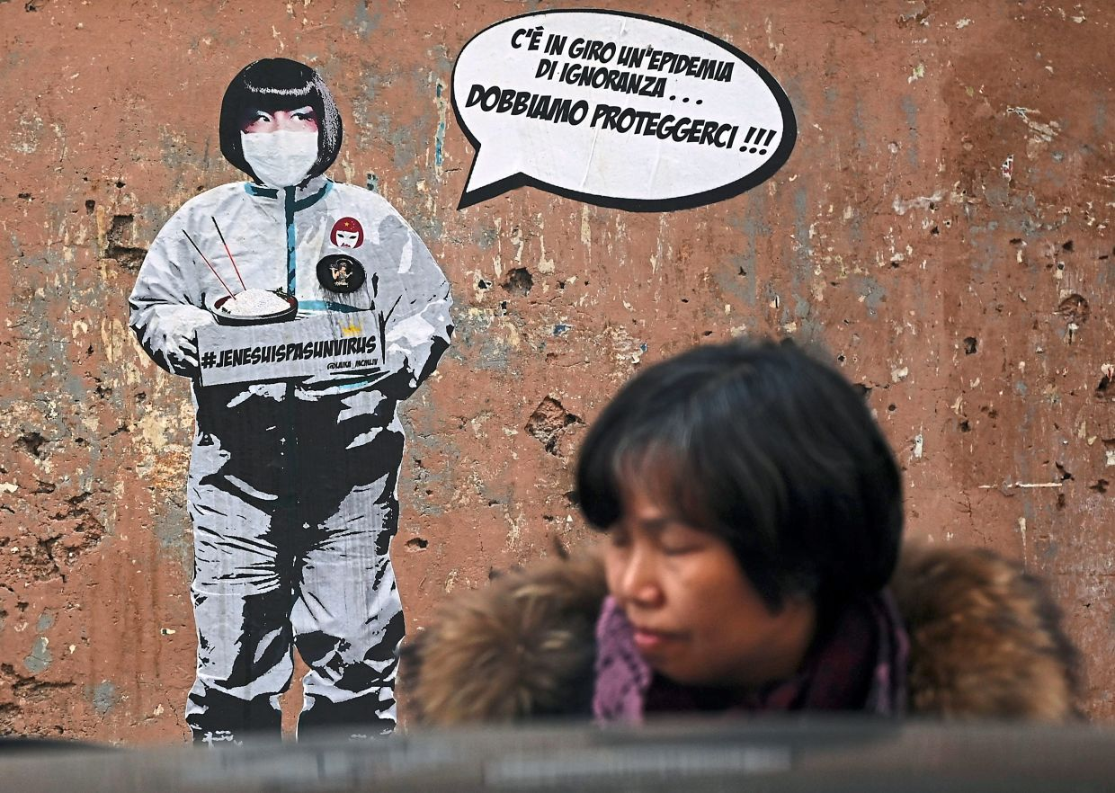 2. Here's a mural by Italian street artist Laika, which features Sonia, the owner of the Hang Zhou restaurant in the Esquilino district, best known as the Chinatown of Rome. The mural tackles the ignorance and xenophobia surrounding Covid-19. Sonia, dressed in white surgical costume and face mask, has a speech bubble which reads (in Italian):