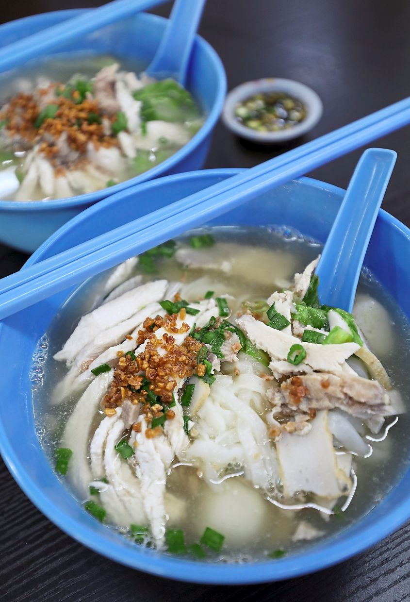 The Penang-style kuey teow thng is served with a generous portion of sliced chicken, duck and pork as well as fish balls and fish cakes. — Photos: SAMUEL ONG/The Star