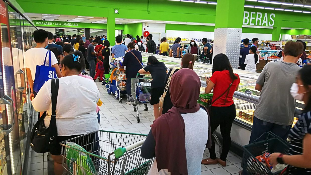 Long queues of shoppers rushing to buy groceries at a hypermarket in Bayan Baru on Tuesday.