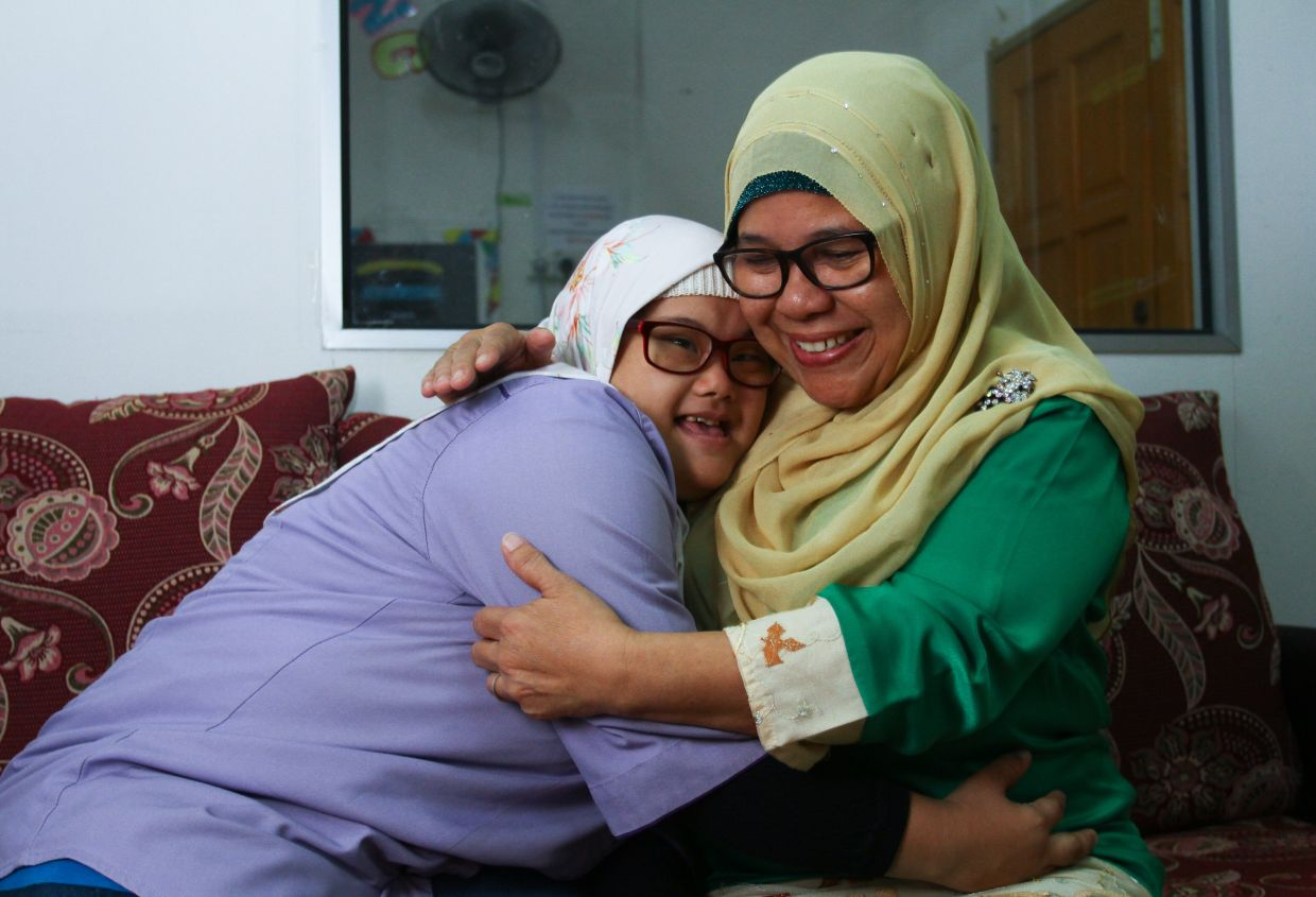 Hanizan Hussin is elated that her special needs child has gained employment. Photo: The Star/Mohd Sahar Misni