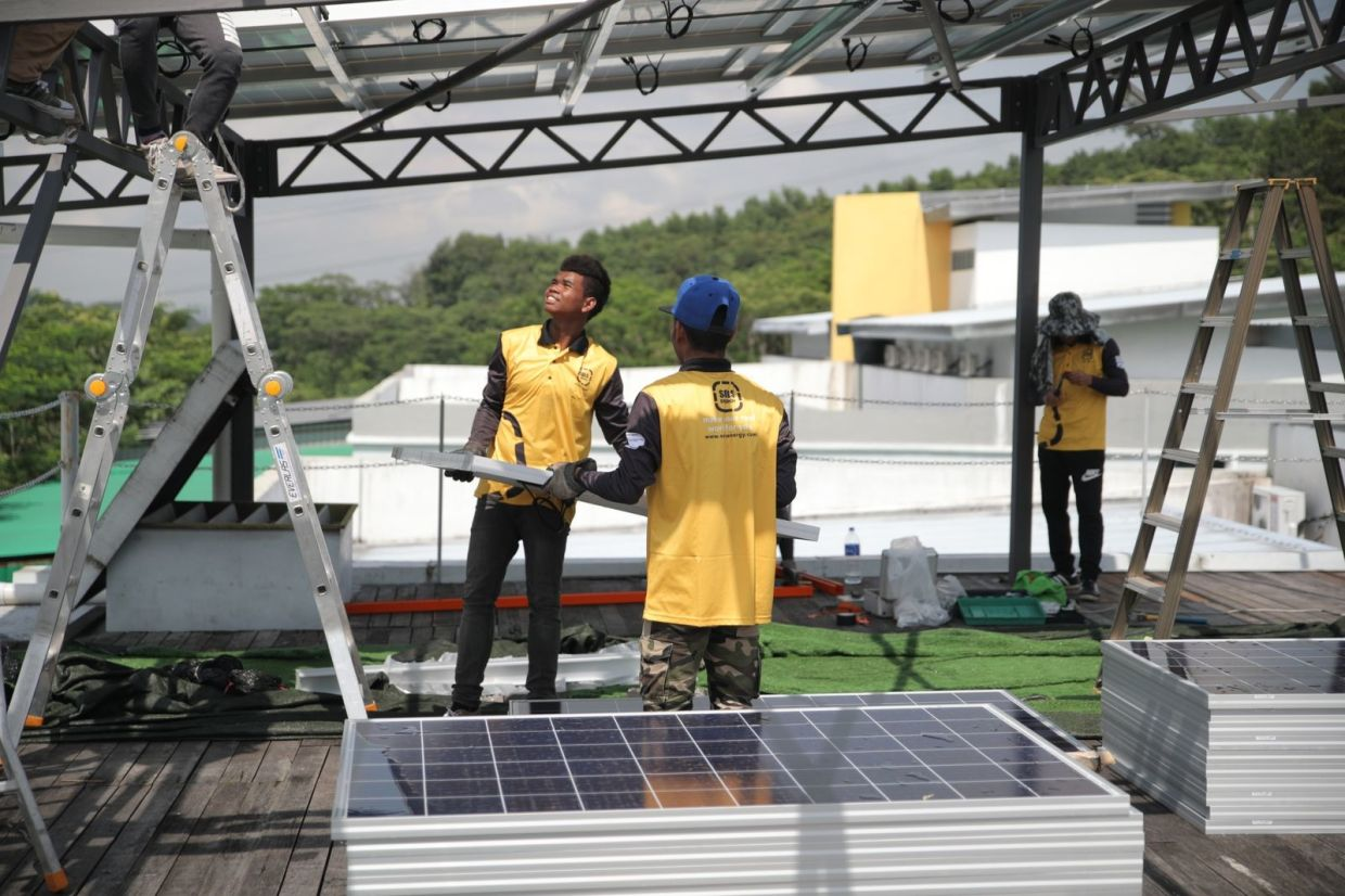 Sols Energy employs and trains orang asli youth to work on its solar panel installation projects, which are primarily for the residential consumer market. — Sols Energy