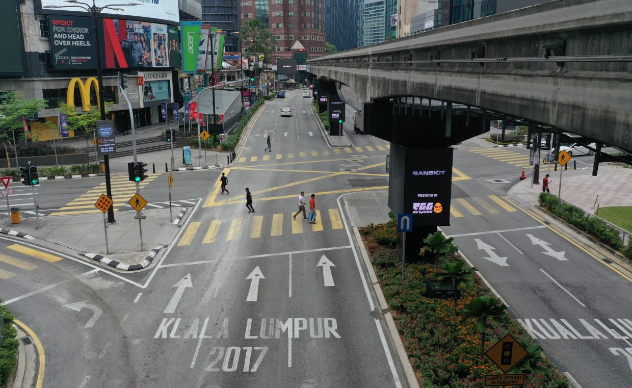 The usually bustling Jalan Bukit Bintang area in KL is relatively deserted during the movement control order in Malaysia. - Bernama