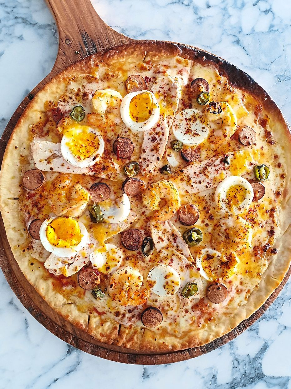 Galvanize Pizza is loaded with chicken, Cajun shrimp, sausage, jalapeno peppers, and boiled egg slices. — Photos: C.S. NATHAN/The Star