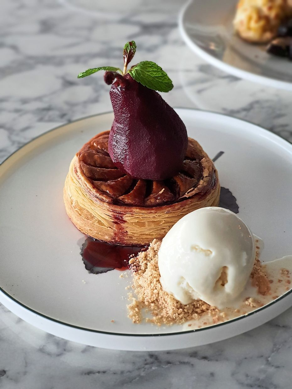 Red Wine Poached Pear with Buttery Flakes Puff Pastry.