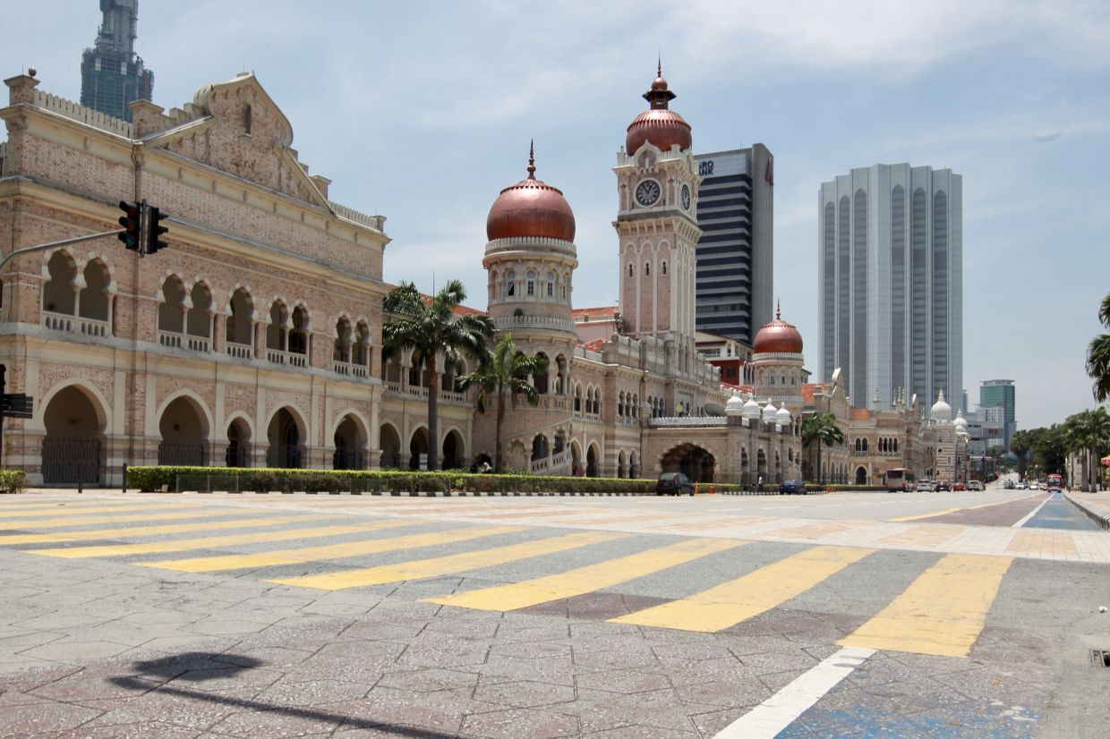 The area around Bangunan Sultan Abdul Samad and Dataran Merdeka, which is a popular tourist spot, is empty during the movement control order in Malaysia. - Filepic