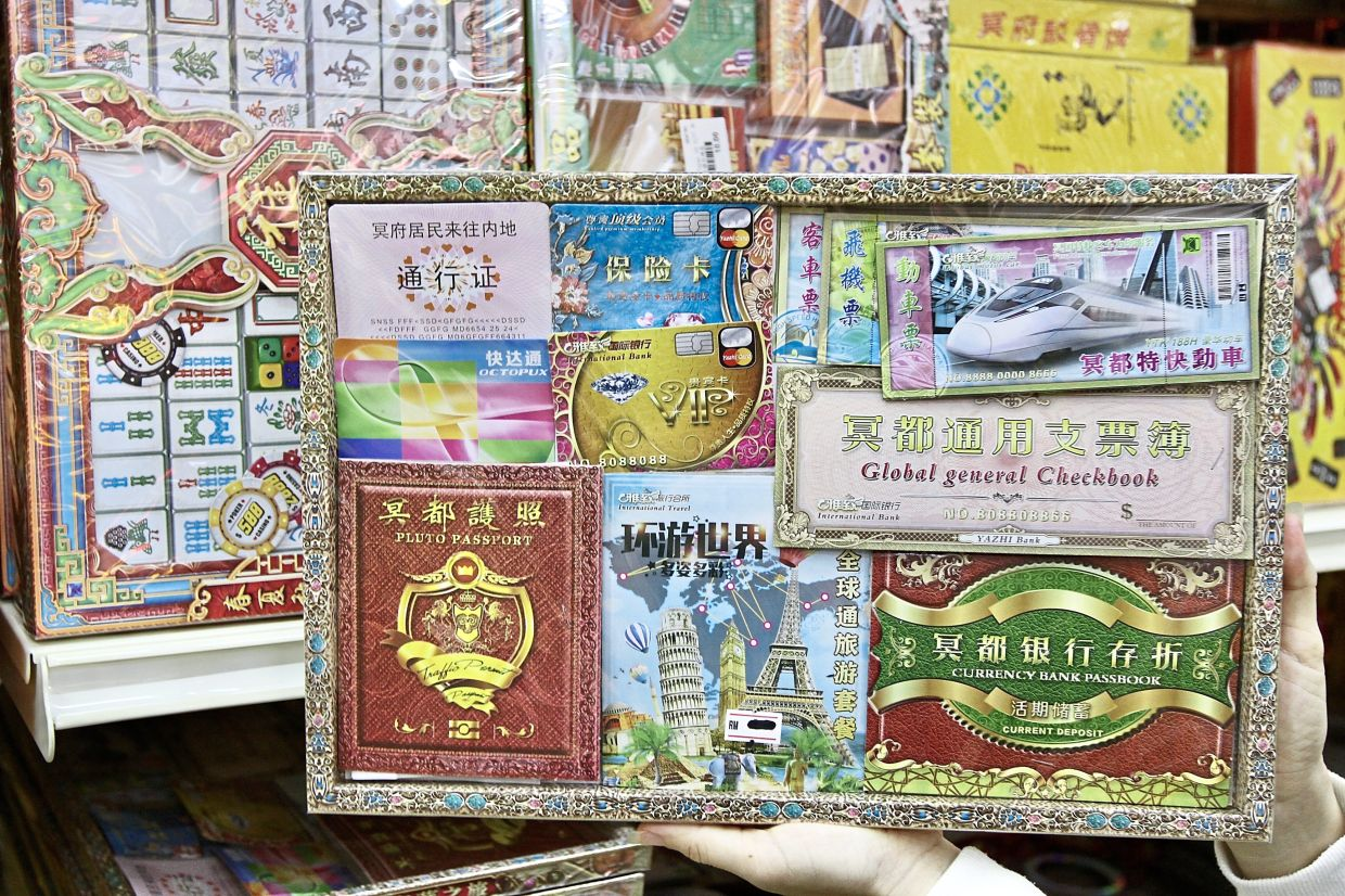 'Credit cards', 'passports' and 'travel passes' for the avid traveller in the afterlife.