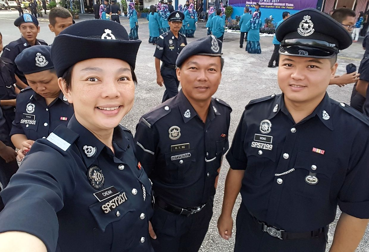 (From left) The writer with her PVR comrades Lance Corporal/SP Ng Kok Yao and Constable/SP Wong Wai Lun.