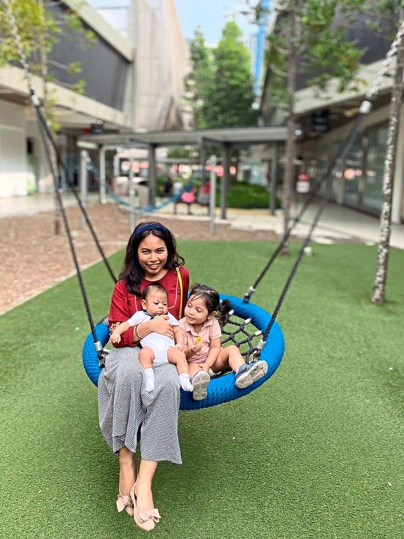 Hanging on: Natasha Zainal said her daughter would cry as she needs to wait for her father to clean up first. (Inset) Saidatul worries about the her husband's safety.