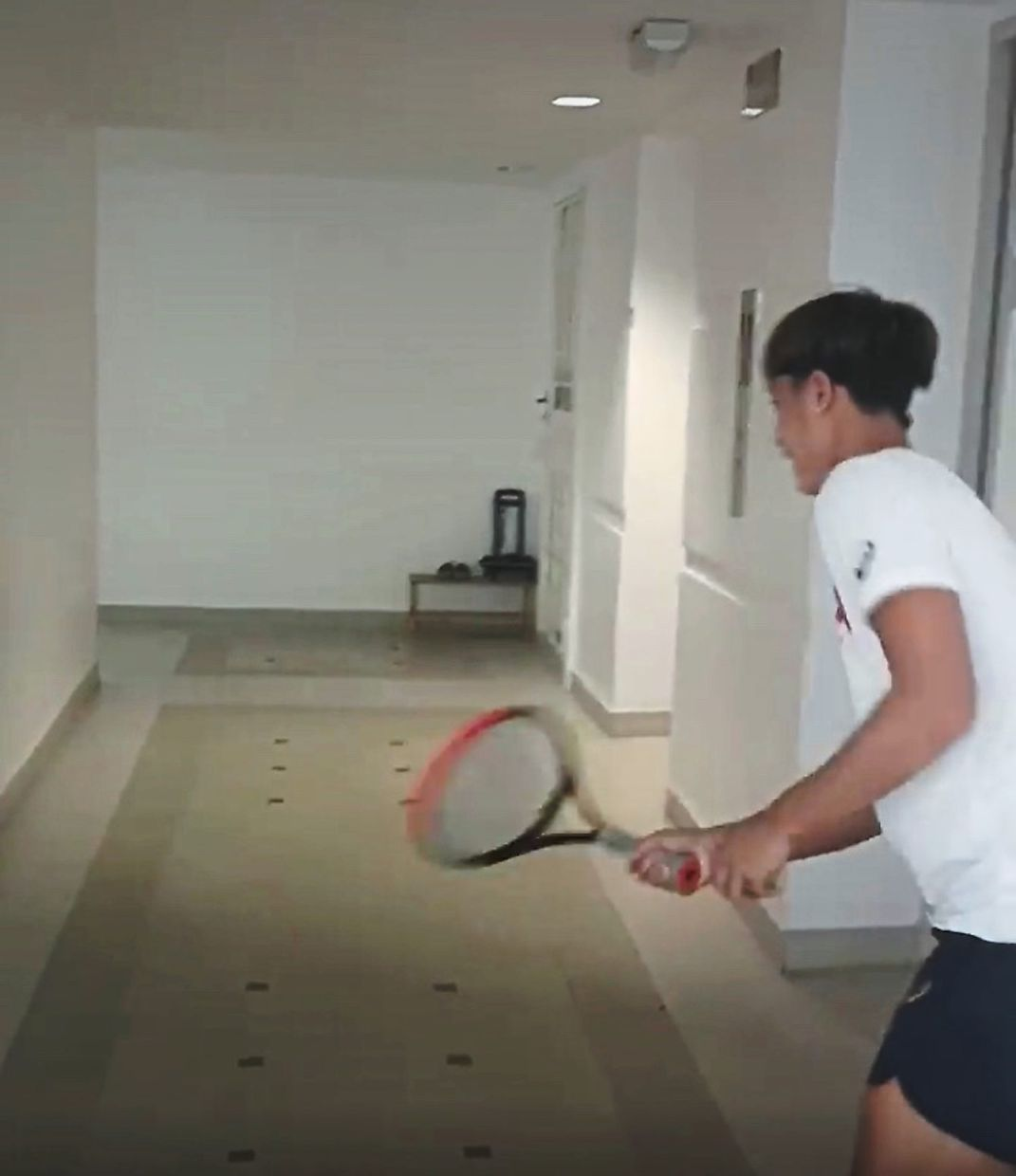 Against the wall: Tennis player Christian Didier Chin practising his shots at home.