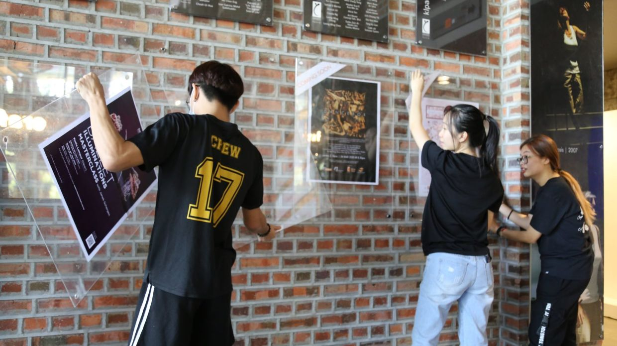 Staff at KLPac taking down theatre show posters last week. The theatre scene has gone quiet with the movement control order, but that hasn't stopped a growing list of theatre practitioners in taking monologue shows, pocket dramas and skits online. Photo: KLPac