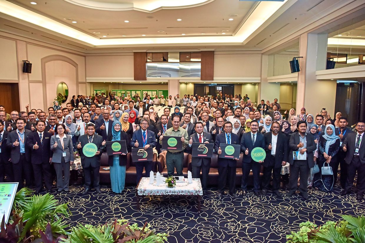 Zainal Azman (in green shirt) with participants of the National Agro Tourism Seminar 2020 in Langkawi, Kedah. The event was held before Covid-19 was declared a pandemic. — Bernama
