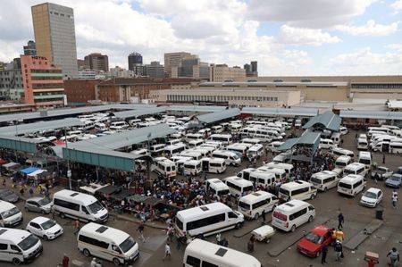 Passengers are seen at taxi rank as residents of a number of African cities where the coronavirus is spreading are heading to the countryside to try to escape from the disease in Johannesburg South Africa March 25 2020. REUTERSSiphiwe Sibeko