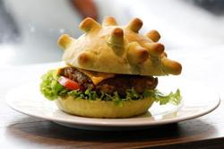 Eat it: Hanoi chef spreads joy with 'Coronaburger'