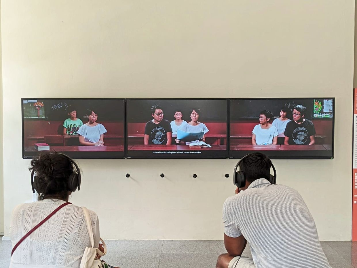 Okui Lala's three-channel video installation 'National Language Class: Our Language' was shown at the recently concluded Singapore Biennale. Photo: Okui Lala