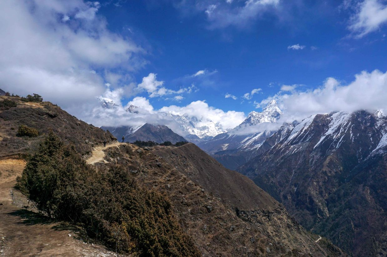 The path along the Mount Everest range is deserted during a government-imposed natiowide lockdown as a preventive measure against the Covid-19. - AFP