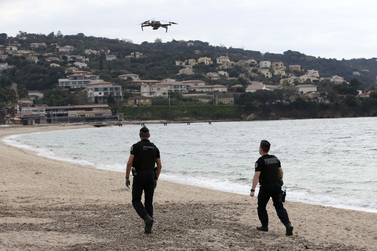 French Gendarmes use a drone as they patrol the beach of Porticcio on the French Mediterranean island of Corsica.