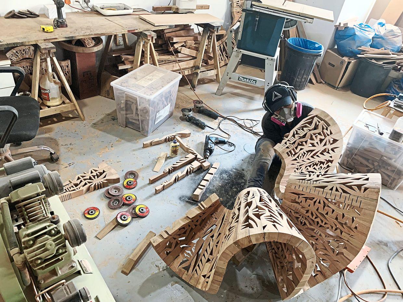 Anniketyni working on a wooden sculpture at her studio in Ara Damansara in Petaling Jaya.